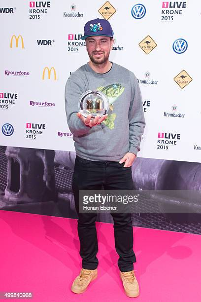 Marten Laciny also called Materia presents his award during the 1Live Krone 2015 at Jahrhunderthalle on December 3 2015 in Bochum Germany