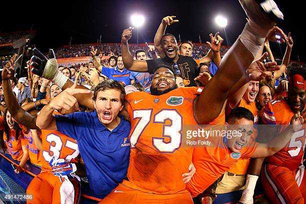 Martez Ivey of the Florida Gators celebrates in the stands with fans after defeating the Mississippi Rebels in the game on October 3 2015 in...