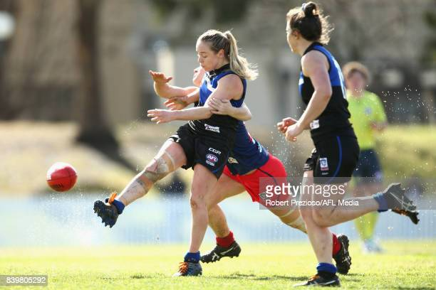Martha Cantwell of Melbourne Uni kicks during the round 14 Women's VFL match between Melbourne University and Diamond Creek at Melbourne University...