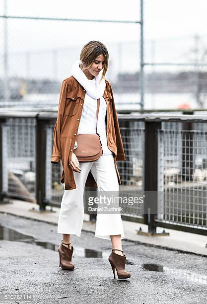 Martha Graeff is seen outside the Coach show wearing a brown coat white sweater white pants brown shoes and a personalized brown bag during New York...