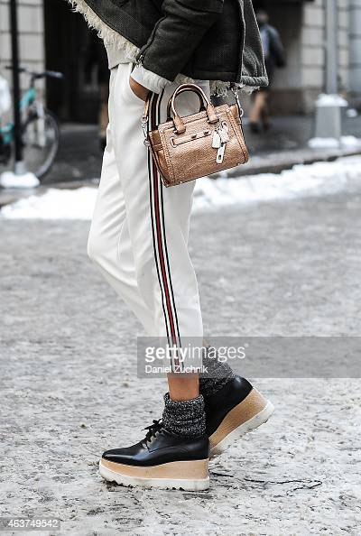 Martha Graeff is seen outside the Diesel Black Gold show wearing a Balenciaga jacket Topshop pants Stella McCartney shoes with a Coach bag on...