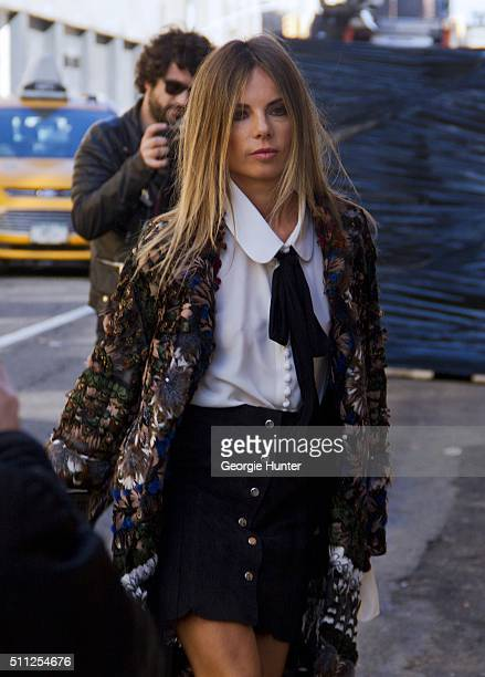 Martha Graeff seen at Skylight Clarkson Sq outside the Ralph Lauren show wearing multicolor feather coat black high waisted skit white shirt and...