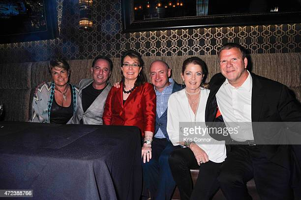 Martha Handler Richard Handler Gabby Giffords Mark Kelly Paige Fertitta and Tilman J Fertitta Chairman and Owner of Landry's INC attends the Grand...