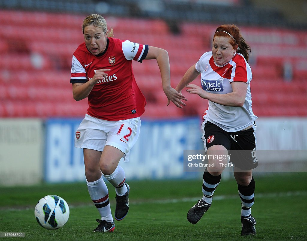 Martha Harris (R) of Lincoln Ladies chases Gemma Davison of Arsenal Ladies during the The FA WSL Continental Cup match between Lincoln Ladies and Arsenal Ladies at Sincil Bank Stadium on May 2, 2013 in Lincoln, England.