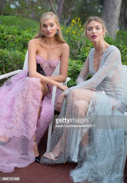 Martha Hunt and Elsa Hosk attend the amfAR Gala Cannes 2017 at Hotel du CapEdenRoc on May 25 2017 in Cap d'Antibes France