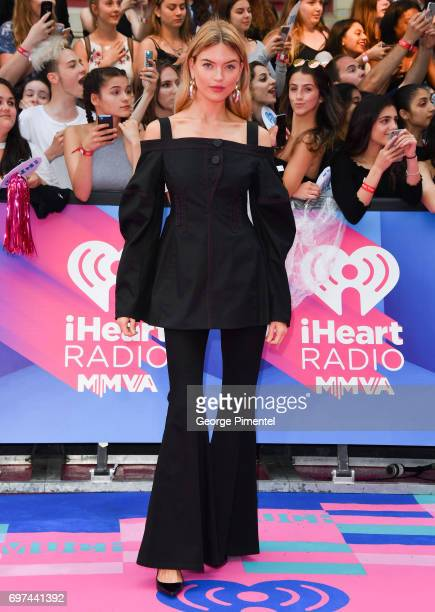 Martha Hunt arrives at the 2017 iHeartRADIO MuchMusic Video Awards at MuchMusic HQ on June 18 2017 in Toronto Canada
