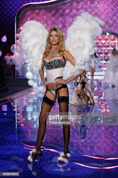 Martha Hunt on the runway at the 2014 Victoria's Secret Runway Show Swarovski Crystal Looks at Earl's Court Exhibition Centre on December 2 2014 in...