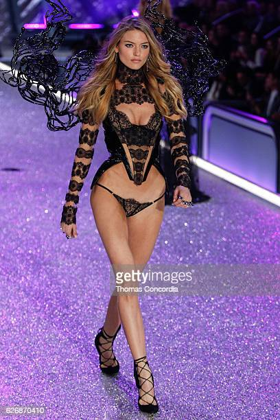 Martha Hunt walks the runway during the 2016 Victoria's Secret Fashion Show at the Grand Palais in Paris on November 30 2016 in Paris France