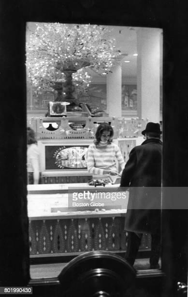 Martha Jeane Mulhern Bonwit a teller clerk is seen through the front door of a bank in Boston Dec 20 1968