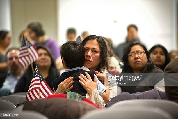 Martha Moran with her sixyearold son Tonatiuh Moran listen during a viewing party for US President Barack Obama's speech on evecutive action...
