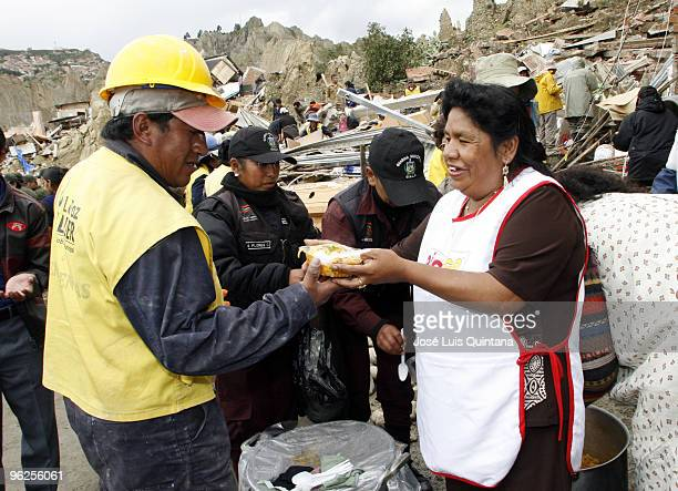 Martha Quisberth Salazar leader of the Federacion de Mercados de la Paz gives food to the rescuers and inhabitants of Bellavista neighborhood after a...