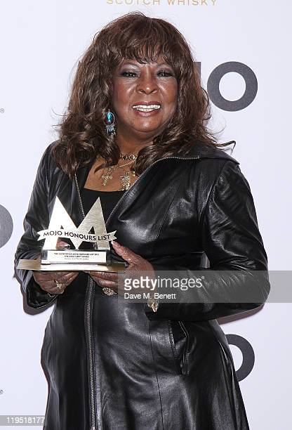 Martha Reeves poses in front of the winners boards with the MOJO Merit Award at the Glenfiddich Mojo Honours List 2011 awards ceremony at The Brewery...