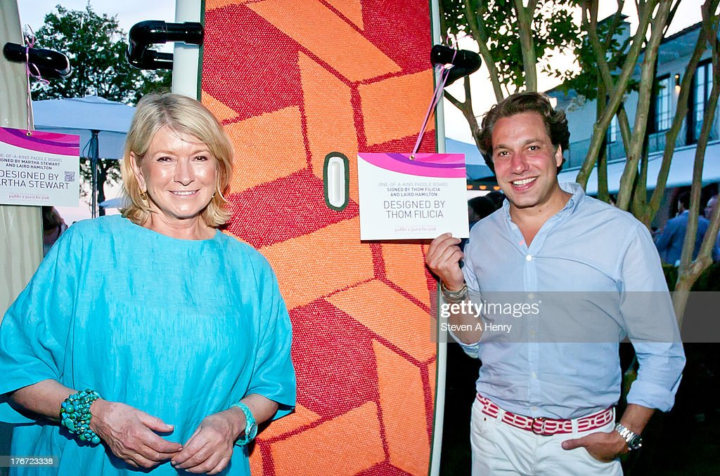 <a gi-track='captionPersonalityLinkClicked' href=/galleries/search?phrase=Martha+Stewart&family=editorial&specificpeople=202905 ng-click='$event.stopPropagation()'>Martha Stewart</a> and <a gi-track='captionPersonalityLinkClicked' href=/galleries/search?phrase=Thom+Filicia&family=editorial&specificpeople=210619 ng-click='$event.stopPropagation()'>Thom Filicia</a> attend the 2nd annual Paddle & Party for Pink on August 17, 2013 in Sag Harbor, New York.