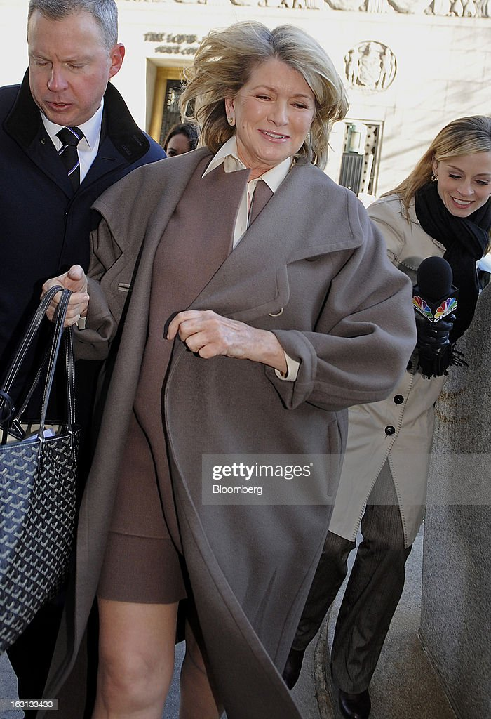 Martha Stewart, founder of Martha Stewart Living Omnimedia Inc., center, arrives at State Supreme court in New York, U.S., on Tuesday, March 5, 2013. Stewart took the stand in a Manhattan courtroom today as Macy's Inc. continues its fight to persuade a New York state judge to block parts of her company's agreement with J.C. Penney Co. Photographer: Louis Lanzano/Bloomberg via Getty Images