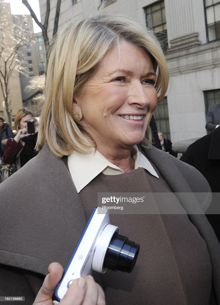 <a gi-track='captionPersonalityLinkClicked' href=/galleries/search?phrase=Martha+Stewart&family=editorial&specificpeople=202905 ng-click='$event.stopPropagation()'>Martha Stewart</a>, founder of <a gi-track='captionPersonalityLinkClicked' href=/galleries/search?phrase=Martha+Stewart&family=editorial&specificpeople=202905 ng-click='$event.stopPropagation()'>Martha Stewart</a> Living Omnimedia Inc., holds a camera while exiting State Supreme court in New York, U.S., on Tuesday, March 5, 2013. Stewart took the stand in a Manhattan courtroom today as Macy's Inc. continues its fight to persuade a New York state judge to block parts of her company's agreement with J.C. Penney Co. Photographer: Louis Lanzano/Bloomberg via Getty Images