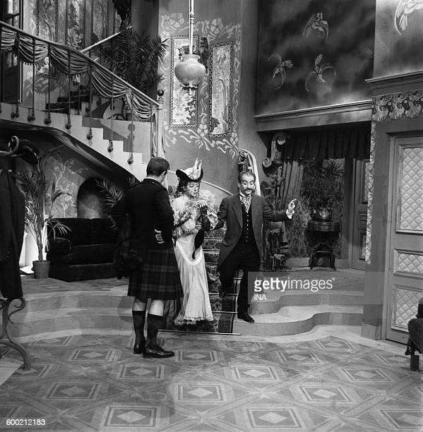 Marthe Mercadier Louis de Funès and Jess Hahn of back in a scene of the theater play 'The flea in the ear' of Georges Feydeau realized by Stellio...