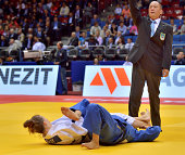 Marti Malloy of the USA armlocks Olympic gold medalist and world champion Kaori Matsumoto of Japan into submission and causing a major upset in the...