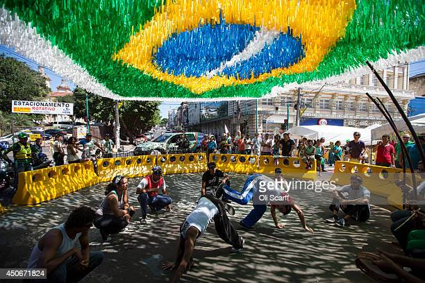 Martial artists perform capoeira to music in central Manaus which is decorated to celebrate the FIFA World Cup on June 15 2014 in Manaus Brazil Group...