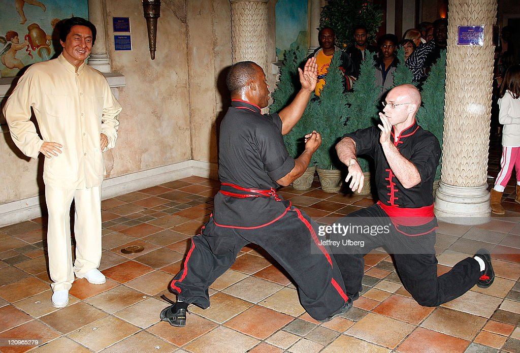 Martial Artists Sharif Bey and <a gi-track='captionPersonalityLinkClicked' href=/galleries/search?phrase=Kim+Martin&family=editorial&specificpeople=242970 ng-click='$event.stopPropagation()'>Kim Martin</a> demonstrate techniques next to <a gi-track='captionPersonalityLinkClicked' href=/galleries/search?phrase=Jackie+Chan&family=editorial&specificpeople=171455 ng-click='$event.stopPropagation()'>Jackie Chan</a>'s wax figure on display and on loan from Madam Tussauds Shanghai, at Madam Tussauds on April 22, 2008 in New York City.