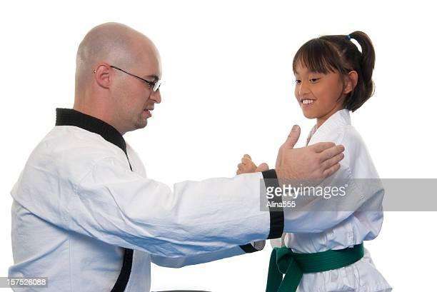 Martial arts instructor is training a new student