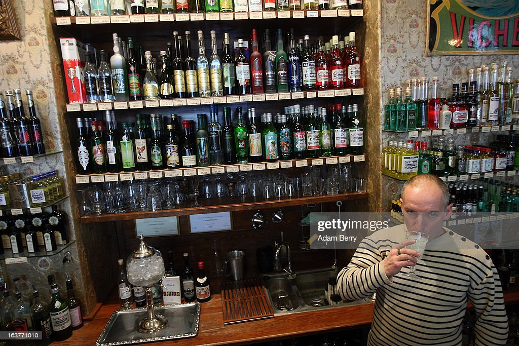 Martial Philippi, owner of the Absinth Depot shop, drinks a glass of absinthe on March 15, 2013 in Berlin, Germany. The highly alcoholic drink absinthe was banned in much of Europe during World War I, and only in recent years became once again legal, finding its way back into bars and shops. Meanwhile the European Parliament is divided on its vote on the European Commission's attempt to standardize the definition of the drink by deciding if and how much of the two substances anethole and the chemical thujone, a toxin extracted from wormwood, which has given the drink its reputation for producing mind-altering effects, must be contained within it to officially classify versions of the 'green fairy,' as it is also known, with the absinthe name.
