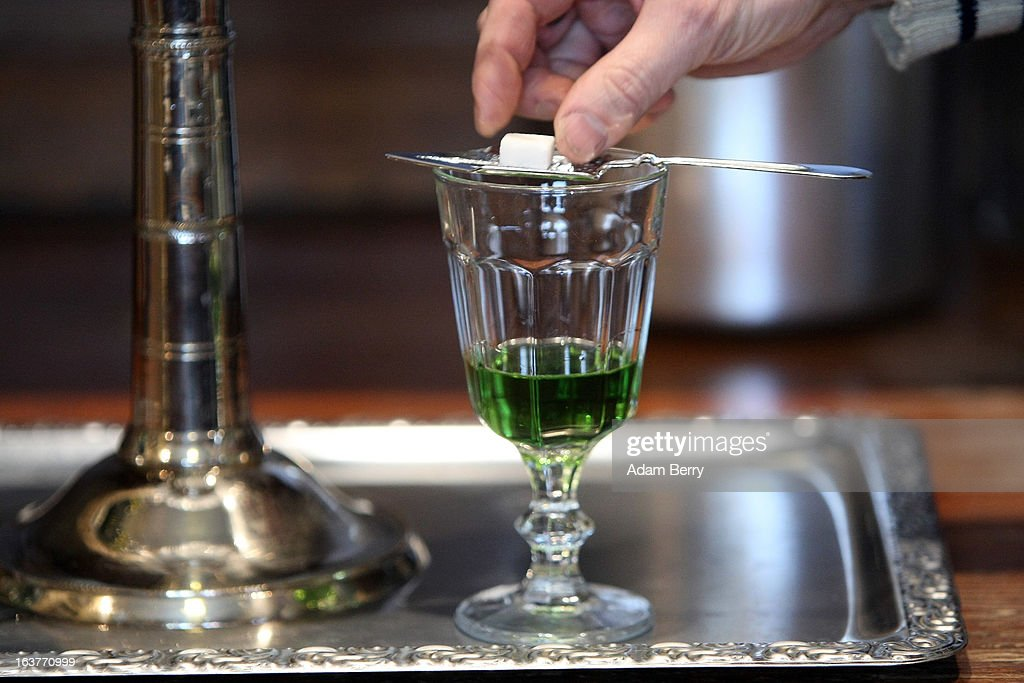 Martial Philippi, owner of the Absinth Depot shop, places a sugar cube onto an absinthe spoon atop a glass of absinthe on March 15, 2013 in Berlin, Germany. The highly alcoholic drink absinthe was banned in much of Europe during World War I, and only in recent years became once again legal, finding its way back into bars and shops. Meanwhile the European Parliament is divided on its vote on the European Commission's attempt to standardize the definition of the drink by deciding if and how much of the two substances anethole and the chemical thujone, a toxin extracted from wormwood, which has given the drink its reputation for producing mind-altering effects, must be contained within it to officially classify versions of the 'green fairy,' as it is also known, with the absinthe name.