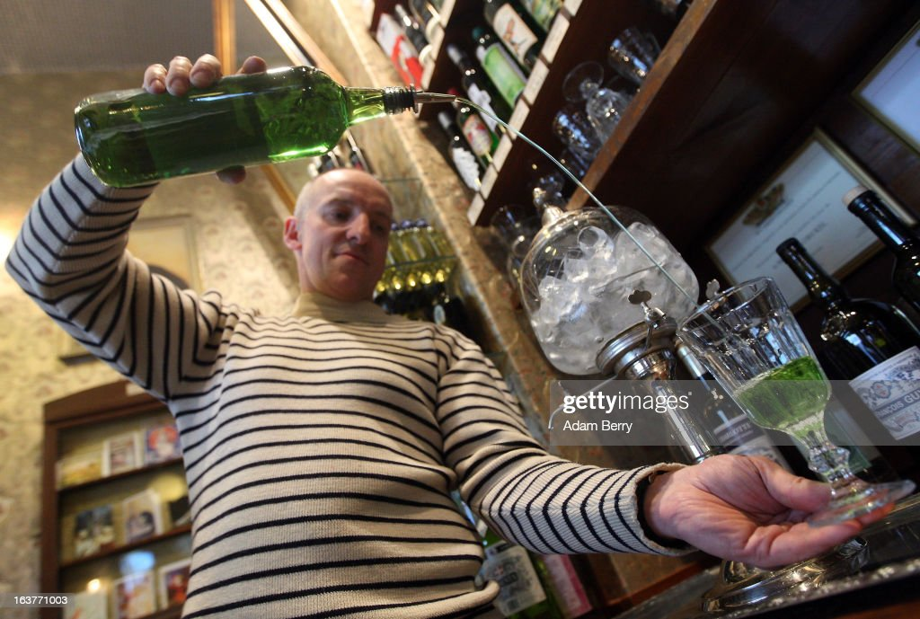 Martial Philippi, owner of the Absinth Depot shop, pours a glass of absinthe on March 15, 2013 in Berlin, Germany. The highly alcoholic drink absinthe was banned in much of Europe during World War I, and only in recent years became once again legal, finding its way back into bars and shops. Meanwhile the European Parliament is divided on its vote on the European Commission's attempt to standardize the definition of the drink by deciding if and how much of the two substances anethole and the chemical thujone, a toxin extracted from wormwood, which has given the drink its reputation for producing mind-altering effects, must be contained within it to officially classify versions of the 'green fairy,' as it is also known, with the absinthe name.