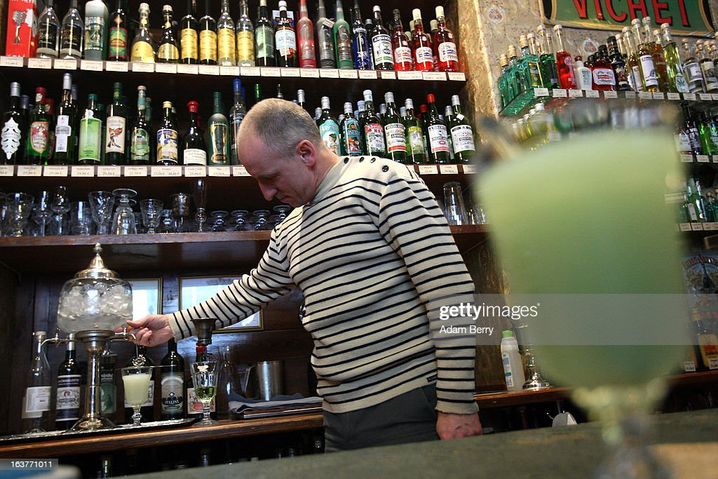 Martial Philippi, owner of the Absinth Depot shop, prepares a glass of absinthe using an absinthe fountain on March 15, 2013 in Berlin, Germany. The highly alcoholic drink absinthe was banned in much of Europe during World War I, and only in recent years became once again legal, finding its way back into bars and shops. Meanwhile the European Parliament is divided on its vote on the European Commission's attempt to standardize the definition of the drink by deciding if and how much of the two substances anethole and the chemical thujone, a toxin extracted from wormwood, which has given the drink its reputation for producing mind-altering effects, must be contained within it to officially classify versions of the 'green fairy,' as it is also known, with the absinthe name.