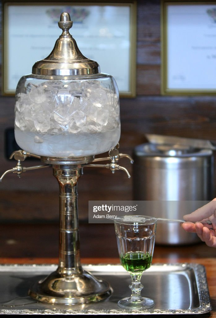 Martial Philippi, owner of the Absinth Depot shop, prepares to use an absinthe fountain to pour water through an absinthe spoon into a glass of absinthe on March 15, 2013 in Berlin, Germany. The highly alcoholic drink absinthe was banned in much of Europe during World War I, and only in recent years became once again legal, finding its way back into bars and shops. Meanwhile the European Parliament is divided on its vote on the European Commission's attempt to standardize the definition of the drink by deciding if and how much of the two substances anethole and the chemical thujone, a toxin extracted from wormwood, which has given the drink its reputation for producing mind-altering effects, must be contained within it to officially classify versions of the 'green fairy,' as it is also known, with the absinthe name.