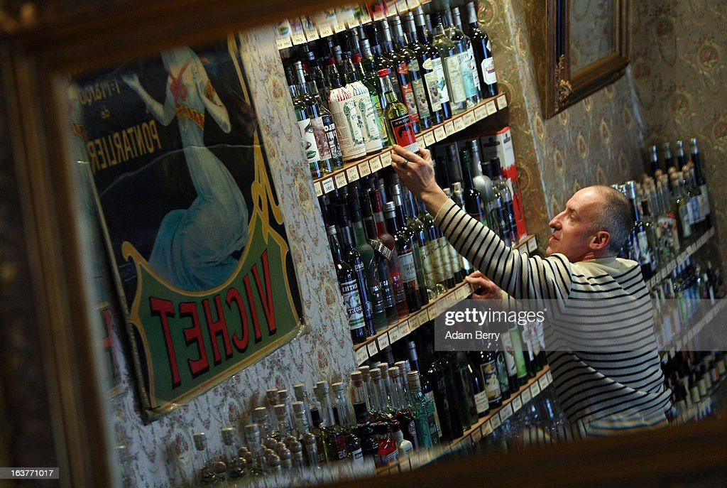 Martial Philippi, owner of the Absinth Depot shop, removes bottles of absinthe from a shelf on March 15, 2013 in Berlin, Germany. The highly alcoholic drink absinthe was banned in much of Europe during World War I, and only in recent years became once again legal, finding its way back into bars and shops. Meanwhile the European Parliament is divided on its vote on the European Commission's attempt to standardize the definition of the drink by deciding if and how much of the two substances anethole and the chemical thujone, a toxin extracted from wormwood, which has given the drink its reputation for producing mind-altering effects, must be contained within it to officially classify versions of the 'green fairy,' as it is also known, with the absinthe name.