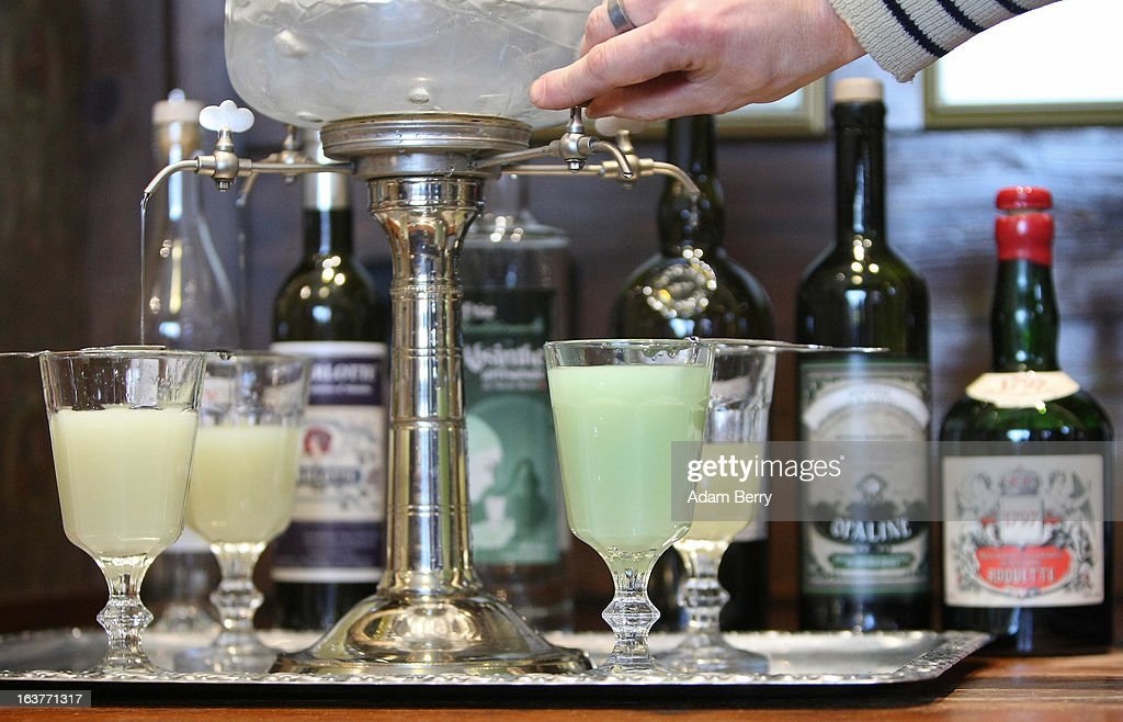 Martial Philippi, owner of the Absinth Depot shop, uses an absinthe fountain to pour water into glasses of absinthe on March 15, 2013 in Berlin, Germany. The highly alcoholic drink absinthe was banned in much of Europe during World War I, and only in recent years became once again legal, finding its way back into bars and shops. Meanwhile the European Parliament is divided on its vote on the European Commission's attempt to standardize the definition of the drink by deciding if and how much of the two substances anethole and the chemical thujone, a toxin extracted from wormwood, which has given the drink its reputation for producing mind-altering effects, must be contained within it to officially classify versions of the 'green fairy,' as it is also known, with the absinthe name.
