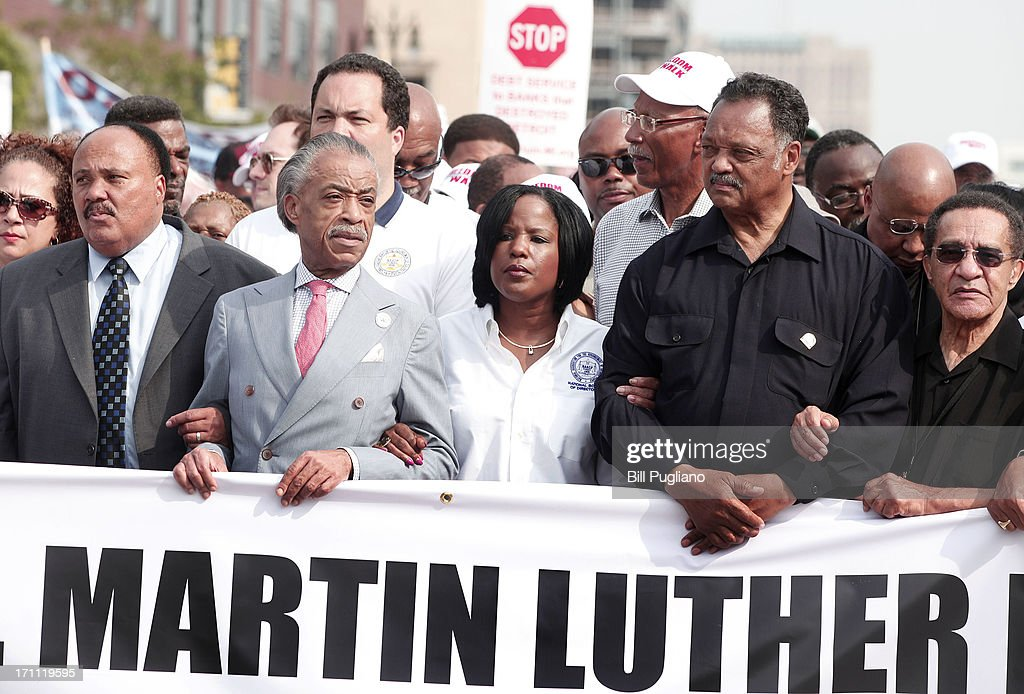 Martiin Luther King III, Rev. Al Sharpton, Roslyn M. Brock and Rev. Jesse Jackson (2nd-R) march in the 50th Anniversary Commemorative Freedom Walk June 22, 2013 in Detroit, Michigan. The march commerates the 50th anniversary of Dr. Martin Luther King's Walk To Freedom.
