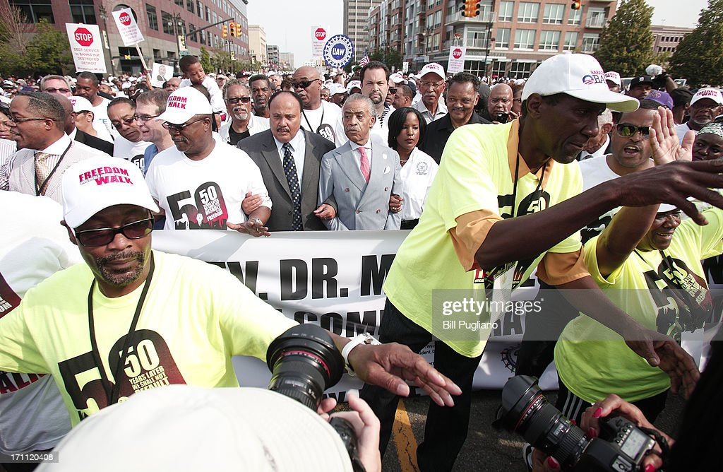Martiin Luther King III, Rev. Al Sharpton, Roslyn M. Brock and Rev. Jesse Jackson march in the 50th Anniversary Commemorative Freedom Walk June 22, 2013 in Detroit, Michigan. The march commerates the 50th anniversary of Dr. Martin Luther King's Walk To Freedom.