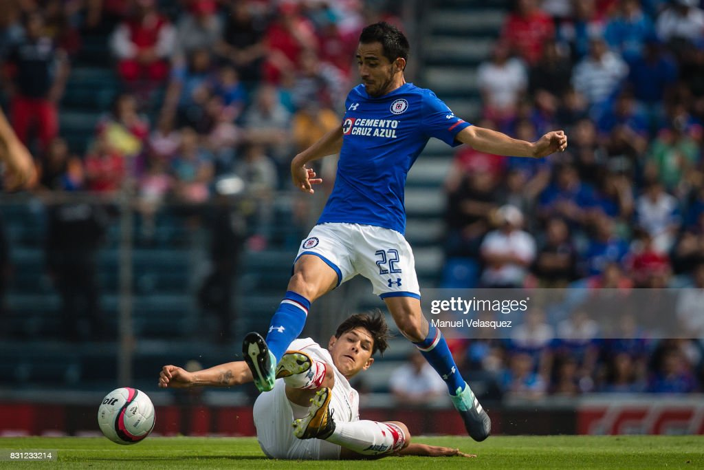 Martin Abundiz (L) of Toluca struggle for the ball with Rafael Baca (R) of Cruz Azul during the 4th round match between Cruz Azul and Chivas as part of the Torneo Apertura 2017 Liga MX at Azul Stadium on August 12, 2017 in Mexico City, Mexico.
