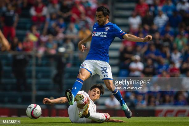 Martin Abundiz of Toluca struggle for the ball with Rafael Baca of Cruz Azul during the 4th round match between Cruz Azul and Chivas as part of the...