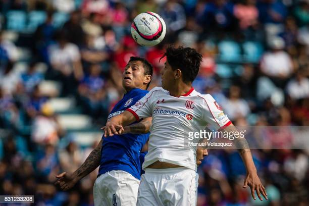 Martin Abundiz of Toluca struggles for the ball against Julio Cesar Dominguez of Cruz Azul during the 4th round match between Cruz Azul and Chivas as...