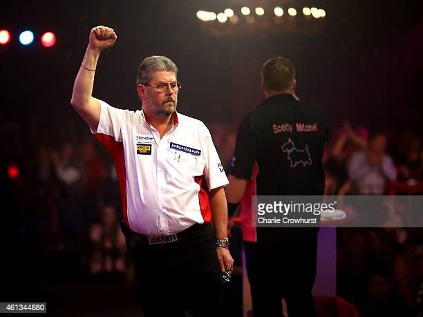 Martin Adams of England celebrates winning a set during the mens final against Scott Mitchell of England during the BDO Lakeside World Professional...