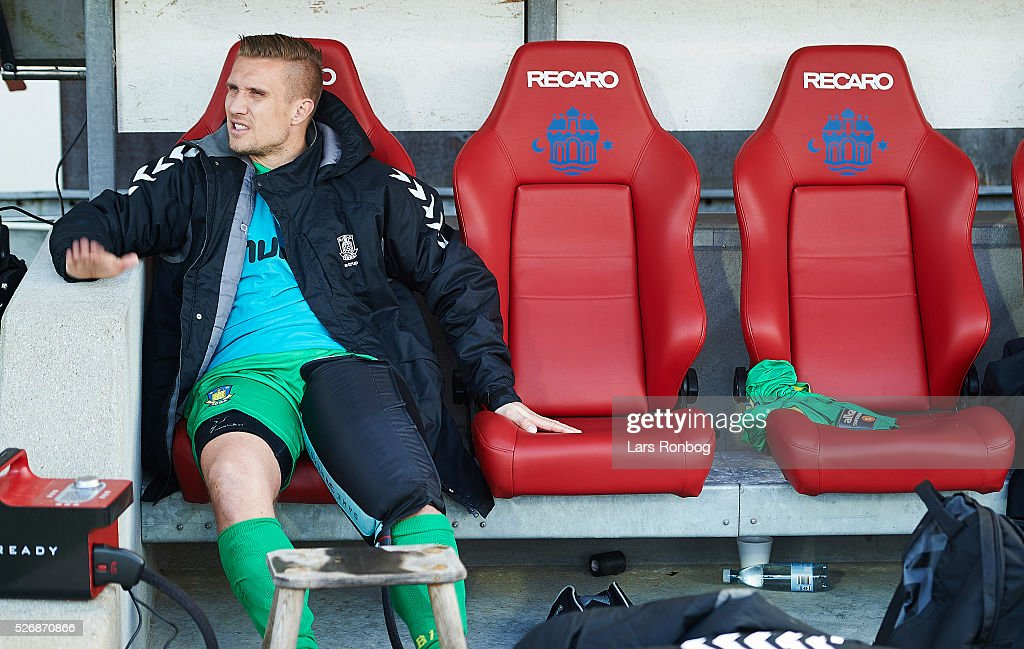 Martin Albrechtsen of Brondby IF sits injured on the bench during the Danish Alka Superliga match between AaB Aalborg and Brondby IF at Nordjyske Arena on May 1, 2016 in Aalborg, Denmark.