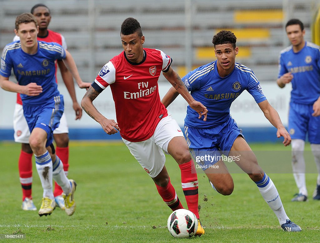 Martin Angha of Arsenal races away from Ruben Cheek of Chelsea during the NextGen Series Semi Final match between Arsenal and Chelsea at Stadio Guiseppe Sinigallia on March 29, 2013 in Como, Italy.