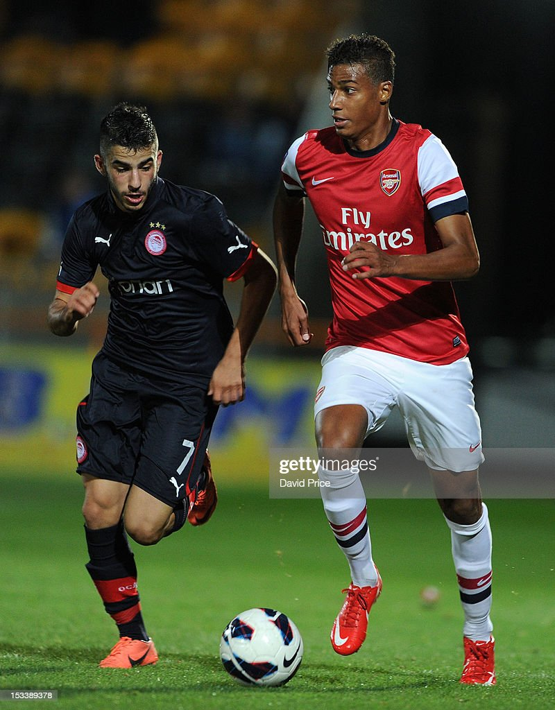 Martin Angha of Arsenal takes on Dimitrios Siopis of Olympiacos during the NextGen Series match between Arsenal U19 and Olympiacos U19 at Underhill Stadium on October 4, 2012 in Barnet, United Kingdom.