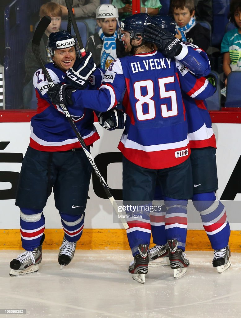 Martin Bartek (#27) of Slovakia celebrate with his team mates after he scores his team's 2nd goal during the IIHF World Championship group H match between Slovakia and USA at Hartwall Areena on May 14, 2013 in Helsinki, Finland.
