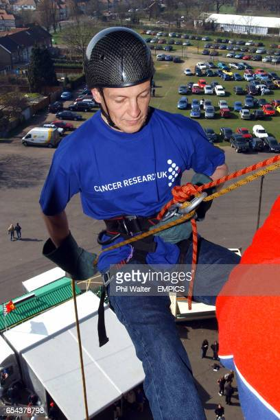 Martin Bayfield prepares to start his abseil