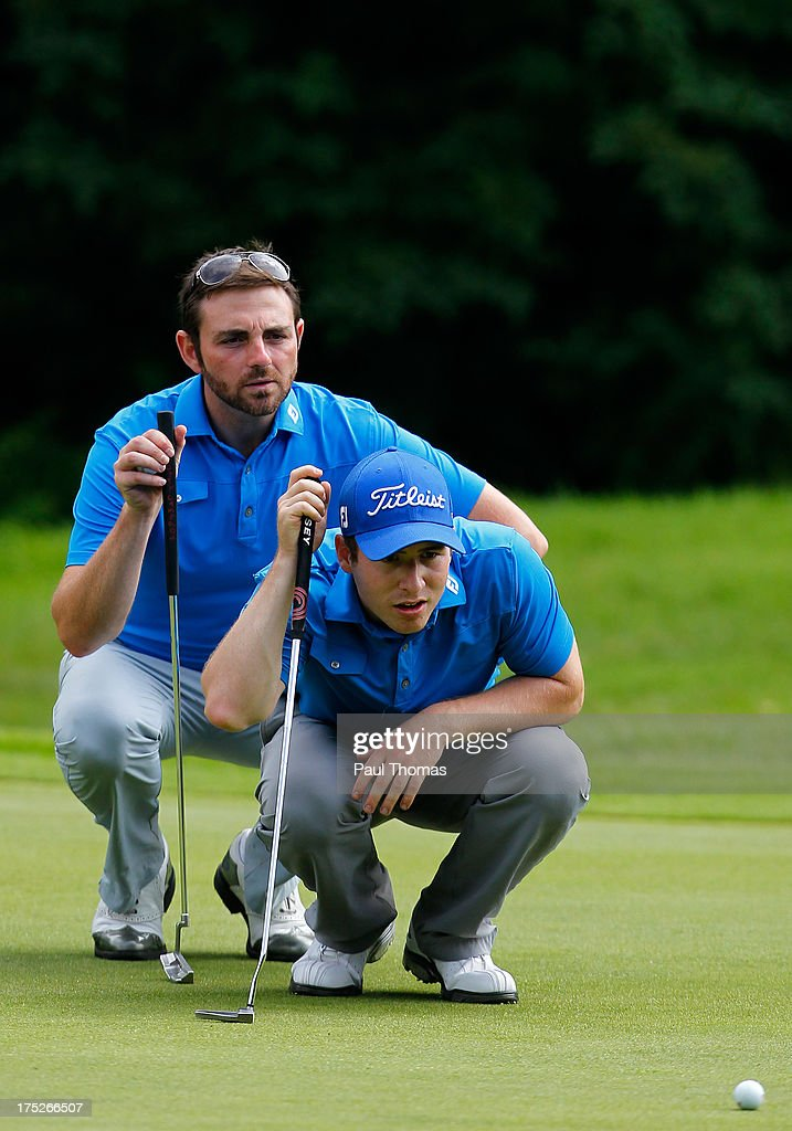 Martin Beaty (L) and Jordan Flint of Crompton & Royton Golf Club discuss lining up a putt during the Golfbreaks.com PGA Fourball Regional Qualifier at Woodsome Hall Golf Club on August 1, 2013 in Huddersfield, England.