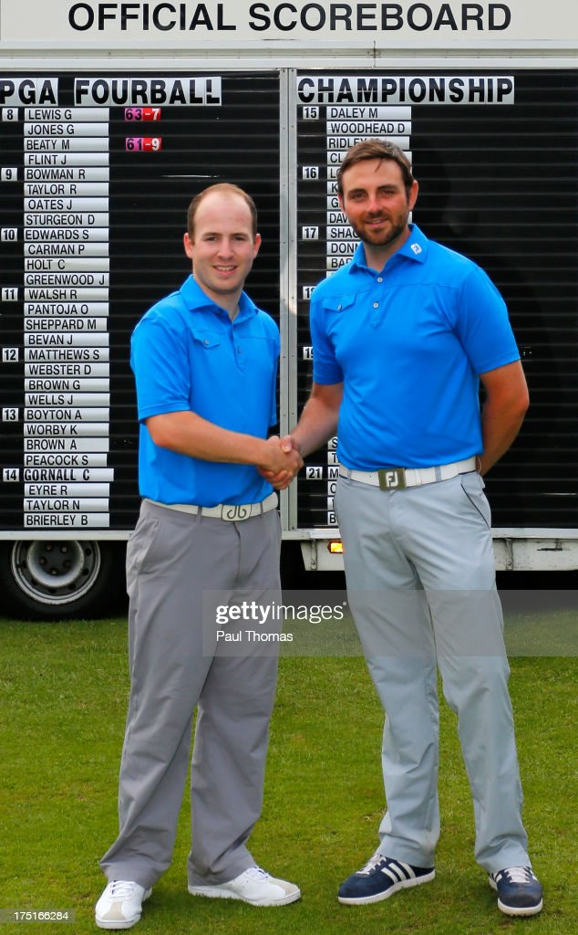 Martin Beaty (R) and Jordan Flint of Crompton & Royton Golf Club pose for a photograph after winning the Golfbreaks.com PGA Fourball Regional Qualifier at Woodsome Hall Golf Club on August 1, 2013 in Huddersfield, England.