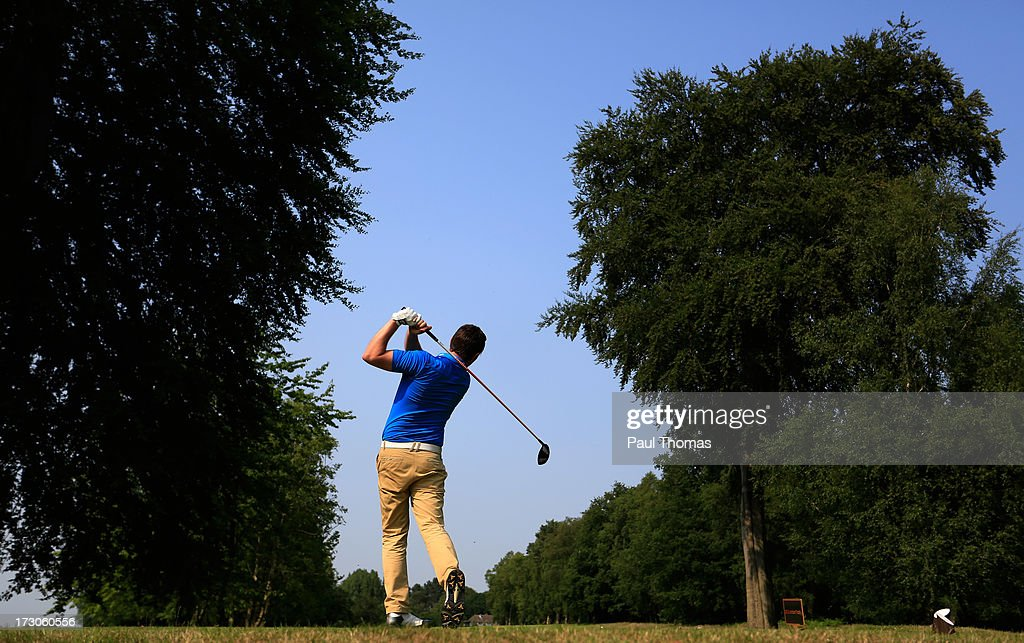 Martin Beaty of Crompton and Royton Golf Club tees off on the 18th hole during the Lombard Trophy PGA National Pro-Am Championship Regional Final at Dunham Forest Golf and Country Golf Club on July 5, 2013 in Manchester, England.