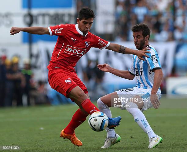 Martin Benitez of Independiente and Francisco Cerro of Racing Club battle for the ball during a second leg match between Independiente and Racing...