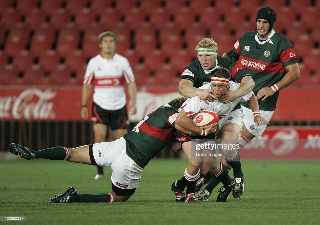 Martin Bezuidenhout of the Lions is tackled by Gavin Williamson and Reginald Kember of the Leopards during the Absa Currie Cup match between the Xerox Lions and Platinum Leopards at Coca Cola Stadium on August 27, 2010 in Johannesburg, South Africa.