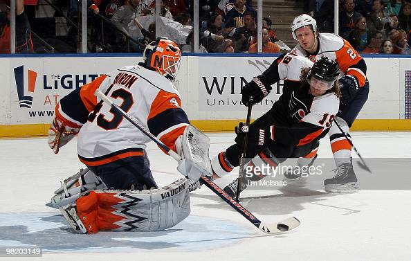 Martin Biron and Mark Streit of the New York Islanders stop a first period scoring chance from Scott Hartnell of the Philadelphia Flyers on April 1...
