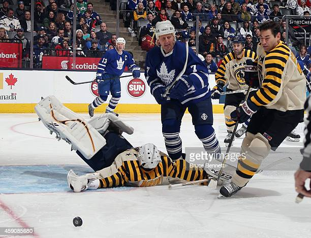 Martin Biron makes the save against Gary Roberts during the Hockey Hall of Fame Legends Classic Game at the Air Canada Centre on November 16 2014 in...