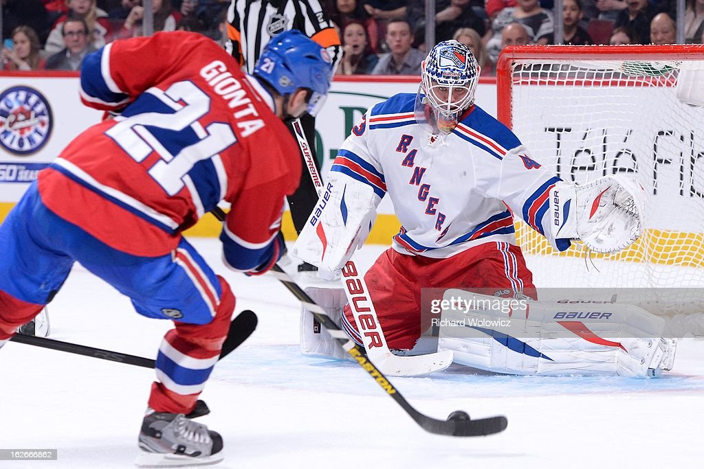 Martin Biron #43 of the New York Rangers gets down to stop the puck on a shot by Brian Gionta #21 of the Montreal Canadiens during the NHL game at the Bell Centre on February 23, 2013 in Montreal, Quebec, Canada. The Canadiens defeated the Rangers 3-0.